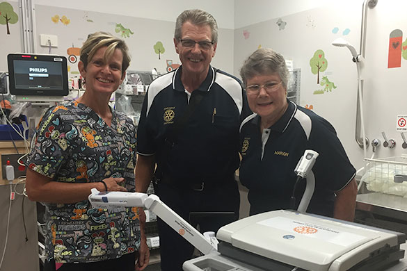 Dr Christa Bell with Graham Cooper and Marion Jones from Southport Rotary Club with the Accuvein and ECG machines purchased for the GCUH Emergency Department through the club's donation.